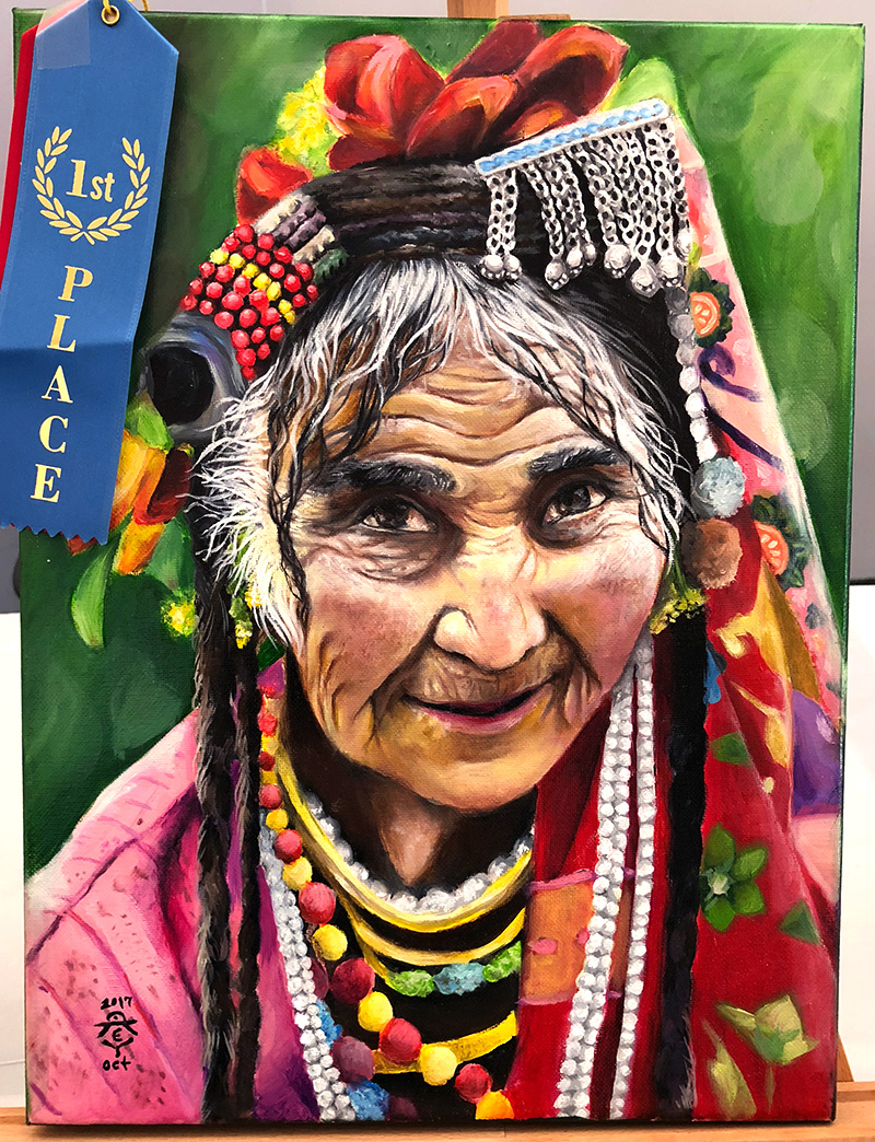 Enya Deng, Student of Oam Studios Art Academy art student, painted a wonderfully calming painting of a smiling woman at our Pleasanton art studio.